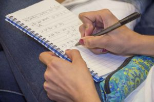 Picture of a person writing