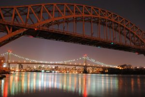 Picture of the RFK Bridge and the New York Connecting Railroad Bridge at night